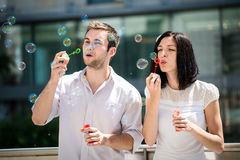 Fun with bubble blower Royalty Free Stock Photos