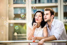 Fun with bubble blower Royalty Free Stock Photography