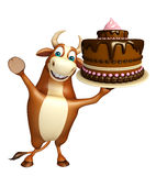 Fun Bull cartoon character with cake Stock Images