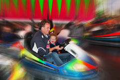 Fun in bumper cars on fair Royalty Free Stock Photos