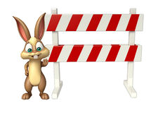 Fun Bunny cartoon character with baracades Stock Photo