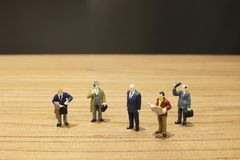 the fun of busines figure on table Royalty Free Stock Image