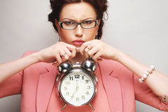 fun businesswoman with alarmclock Stock Photos