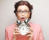 Fun businesswoman with alarmclock Royalty Free Stock Image