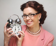 Fun businesswoman with alarmclock Royalty Free Stock Photos