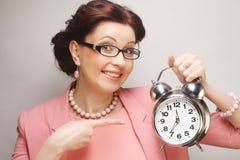 Fun businesswoman with alarmclock Stock Photos