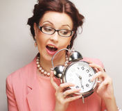 Fun businesswoman with alarmclock Royalty Free Stock Images