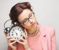 Fun businesswoman with alarmclock Stock Photography