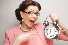 Fun businesswoman with alarmclock Royalty Free Stock Photography