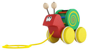 Fun cartoon snail toy. Fun wooden multicoloured cartoon snail toy on wheels with a string for pulling it along isolated on white Stock Photography
