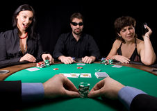 Fun in casino. Company of friends having fun in the casino poker table Stock Photo
