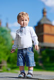 Fun caucazian blond boy. Summer outdoors Royalty Free Stock Photos