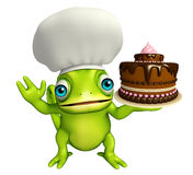 Fun Chameleon cartoon character with cake and chef hat Stock Photos