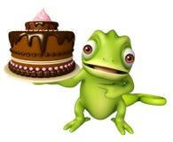 Fun Chameleon cartoon character with cake Stock Photos
