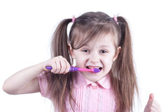 Fun child cleaning teeth isolated on white background Royalty Free Stock Photography