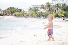 Fun: Child on Tropical Beach Royalty Free Stock Photos