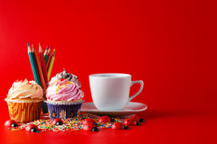 Fun children breakfast. Cupcake on brigth red background Stock Photography