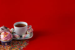 Fun children breakfast. Cupcake on brigth red background Stock Photo