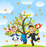 Fun children run to school in the autumn alley Stock Images