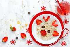 Fun Christmas breakfast idea for kids oatmeal bowl with fruit in Stock Photos