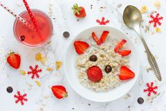 Fun Christmas breakfast idea for kids oatmeal bowl with fruit in Royalty Free Stock Images