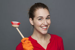 Fun cleaning concept for attractive 20s girl Royalty Free Stock Photos