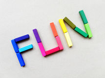 Fun in color pastels. Fun back to school! - a still life image with the letters of the word FUN spelled out in bright and colorful artist pastels, taken with a Stock Image