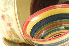 Fun with colored bowls. Bright colorful bowls artfully arranged and placed, in this case on the kitchen counter,are sure to draw comments and as happen here royalty free stock photography