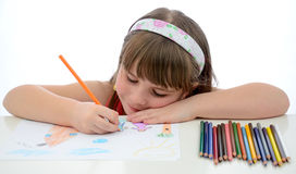 Fun with colored crayons. Close perspective drawing for young girl Royalty Free Stock Photos