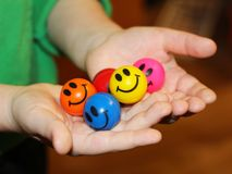 Fun colorful balloons in children`s hands, object stock photography