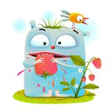 Little monster eating strawberry Royalty Free Stock Images