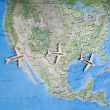 Fun Colorful North America USA travel map with airplanes. Fun and colorful North America map, three mini wooden airplanes magazines agents adverts websites stock photography