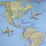 Fun Colorful North America USA travel map with airplanes. Fun and colorful North America map, three mini wooden airplanes magazines agents adverts websites royalty free stock photography