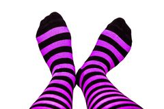Fun striped socks with feet. Fun colorful purple and black striped socks on  background background Stock Photography