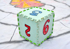 Fun colorful toy puzzle cube or dice in textured foam for kids to learn their numbers 2 , 3,9. Picture of a Fun colorful green toy puzzle cube or dice in Stock Images