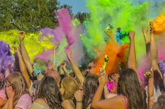 The fun of colors. Festival of colors, fun young people colored flour Royalty Free Stock Photo
