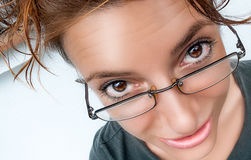 Fun Comic Girl. Funny Expression. Closeup of Girl's Eyes with glasses and funny expression on her face. Fisheye lens Royalty Free Stock Photo