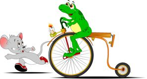 Fun competitions. Frog on a bike competing in the race with a small little mouse Royalty Free Stock Image