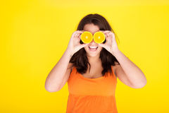 Fun Concept Model With Orange Slices For Eyes Royalty Free Stock Photography