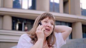Fun conversation joy surprise curiosity woman. Fun conversation. Joy surprise curiosity. Positive woman talking on phone sharing news stock footage