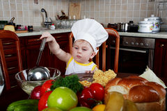 Fun cook. Little cook: fruits and baby food Royalty Free Stock Photography
