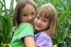 Fun in the corn field. 2 girls playing in a corn field Stock Photography