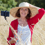 Fun countryside selfy for mature woman's vacation memories Stock Photography