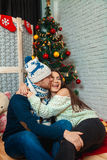 Fun couple celebrates Christmas Stock Photos