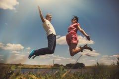 Fun couple in jump Stock Photography