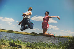 Fun couple in jump Stock Images