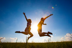 Fun couple in jump on the outdoor background Stock Photo