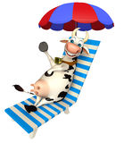 Fun Cow cartoon character with beach chair. 3d rendered illustration of Cow cartoon character with beach chair Royalty Free Stock Photography