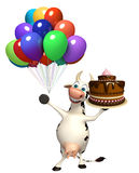 Fun Cow cartoon character with cake Royalty Free Stock Photography