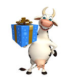 Fun Cow cartoon character with gift box Stock Photo